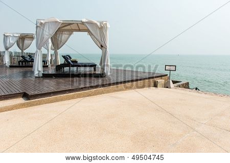 Beach Front Dual Leather Relax Chairs Inside A Tent Facing The S