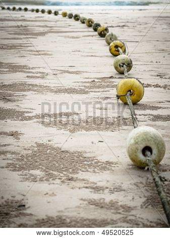 Old Buoys On The Beach