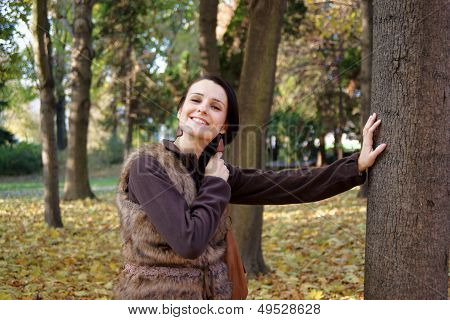 Autumn woman wearing fur vest