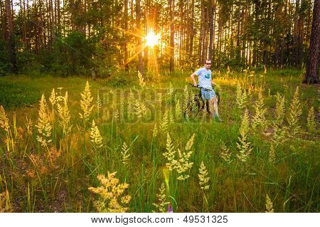 Young Man On The Gt Bicycle Biking Through A Sunny Forest. Minsk, Belarus - June 14: Young Man On Th