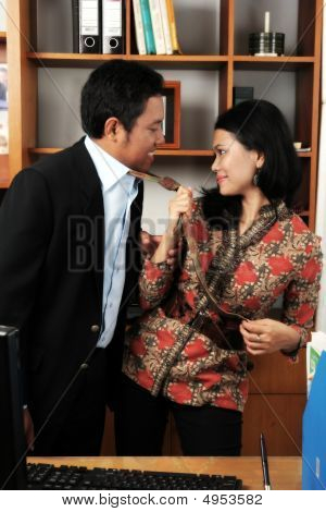 Portrait Of Couple Affair In Office