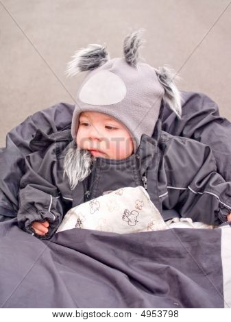 Cute Baby Boy Looking Thoughtful Sitting In Pram