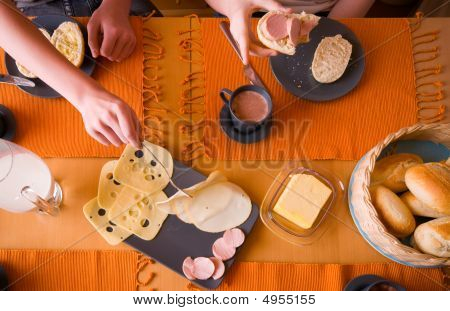Hand With Fork And Plate With Cheese