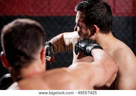 Punching an opponent during a fight