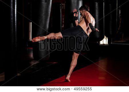 Doing some kicks on a punching bag