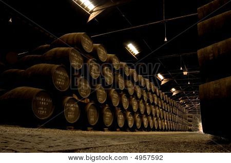 Porto Wine Barrels In A Warehouse