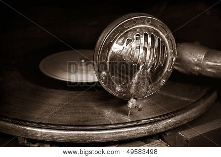 Head With An Old Gramophone Needle On The Vinyl Disc