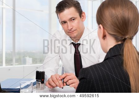 Young woman with a financial advisor