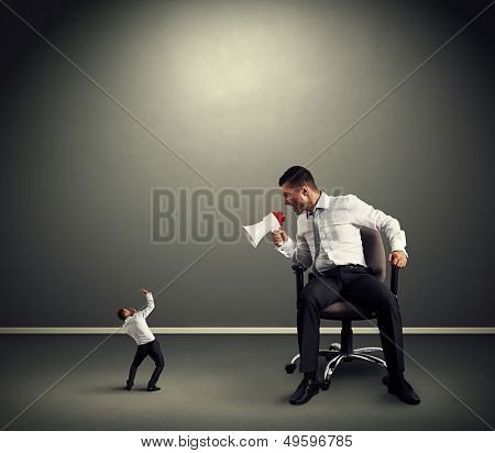 big boss with small businessman in grey room