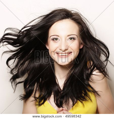 Young happy woman with wind in hair