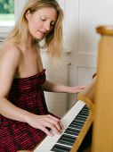 Adult Female Playing The Piano