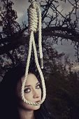 foto of gallows  - Pretty girl with gallows in the forest - JPG
