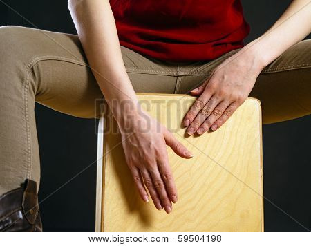 Closeup Of A Woman Playing The Cajon