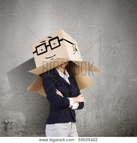 Conceptual image of businesswoman with carton box on head