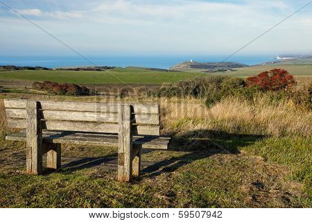 Empty Wooden Bench Facing English Countryside