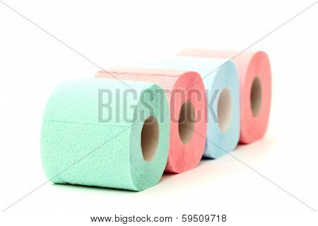 Four colorful toilet paper rolls