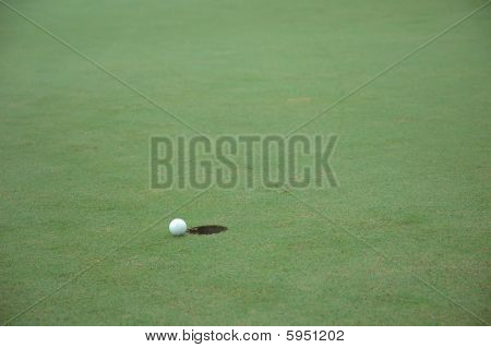 Golf Ball Closely To The Hole