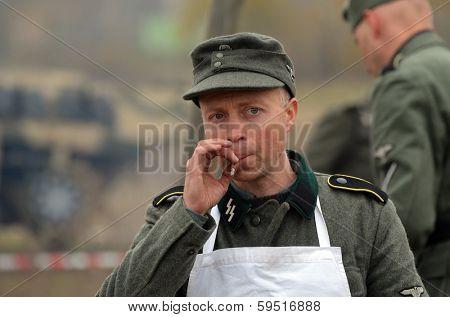 KIEV, UKRAINE -NOV 2: An unidentified member of Red Star history club wears historical German uniform during historical reenactment of WWII, Dnepr river crossing 1943, November 2, 2013. Kiev, Ukraine