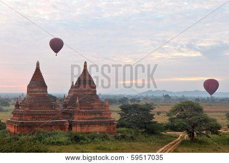 BAGAN, MYANMAR - DEC 07, 2013 Buddhist temples in Bagan and air balloons, Myanmar