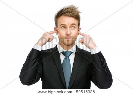 Half-length portrait of businessman closes his ears, isolated on white. Concept of noise and stress