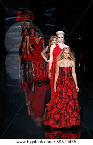 NEW YORK-FEB 6: Annasophia Robb and Ireland Baldwin on the runway at The Heart Truth Red Dress Collection show during Mercedes-Benz Fashion Week at Lincoln Center on February 6, 2014 in New York City.
