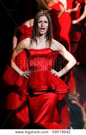 NEW YORK-FEB 6: Actress Jill Hennessy reacts on the runway at The Heart Truth Red Dress Collection show during Mercedes-Benz Fashion Week at Lincoln Center on February 6, 2014 in New York City.