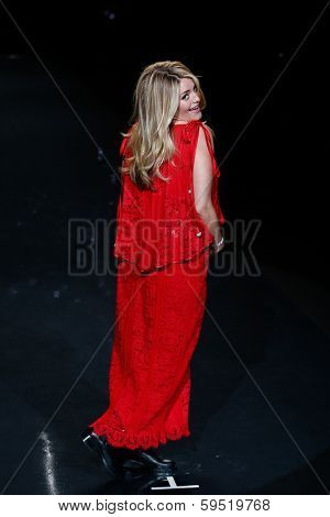 NEW YORK-FEB 6: TV host Daphne Oz wears Sarah Liller on the runway at Heart Truth Red Dress Collection show during Mercedes-Benz Fashion Week at Lincoln Center on February 6, 2014 in New York City.