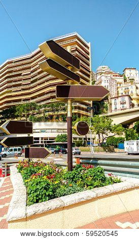 Signpost And Street View Of Fontvieille. Principality Of Monaco