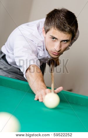 Male playing billiard. Spending free time on gambling