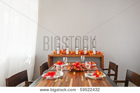 Dinner Table Setting In Warm Orange Red Colors