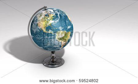 A Realistic Globe On A Chrome Pedestal Over White A