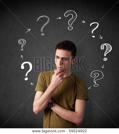Thoughtful young man with drawn question marks circulating around his head