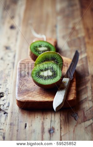 Halved Kiwi Fruits on a Chopping Board