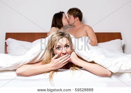 Cheeky Young Woman In A Threesome In Bed