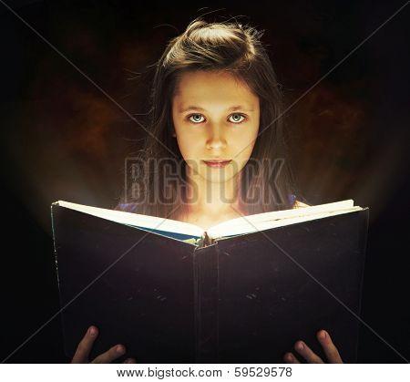 Girl opened a magic book