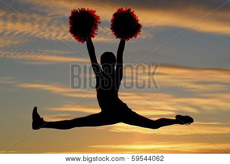 Cheerleader Silhouette Leaping In Air Doing The Splits With A Sunset Background