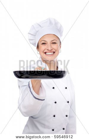 portrait of friendly chef woman holding pan on white background