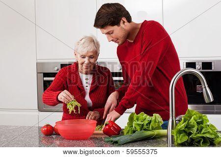 Grandson Helping In Kitchen