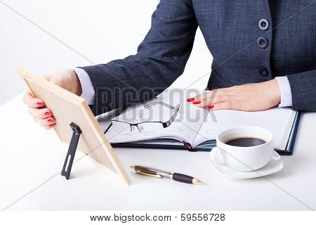 Sentimental Businesswoman By Her Desk