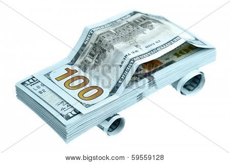 Car made of new hundred dollar bills isolated over the white background