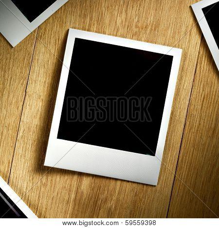Polaroid Film Vintage empty photo cards on wood background