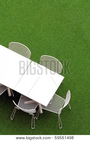 Chair and table on lawn at outdoor