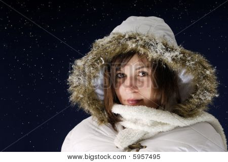 Nightshot Of Young Woman With Wintercoat Against Starfield