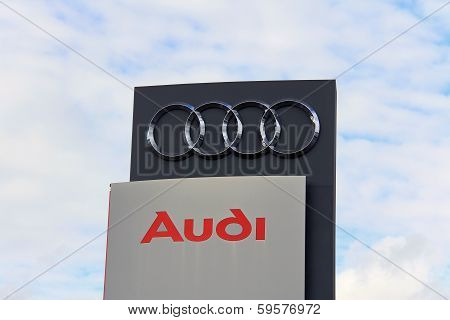 Sign Audi Against Sky