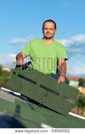 Roofer On Top Of Building
