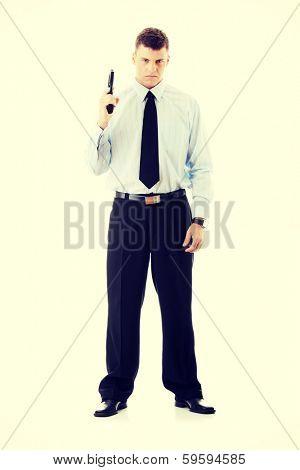 Gun control concept - businessman with handgun
