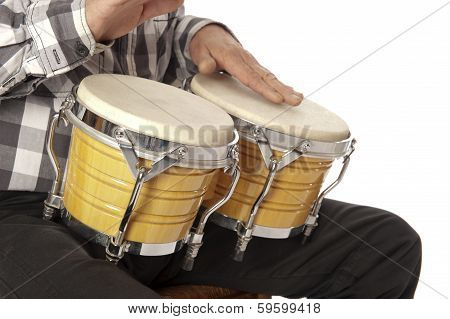 Man Playing Bongo On His Lap