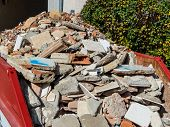 picture of eviction  - rubble from the demolition of a residential building in a container - JPG