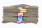 stock photo of two dollar bill  - Bank bundles of different denomination dollar bills stacked on top of each other and secured with two rubber bands - JPG