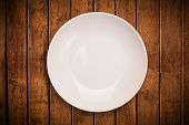 image of cook eating  - Colorful empty shiny plate on grungy background table - JPG